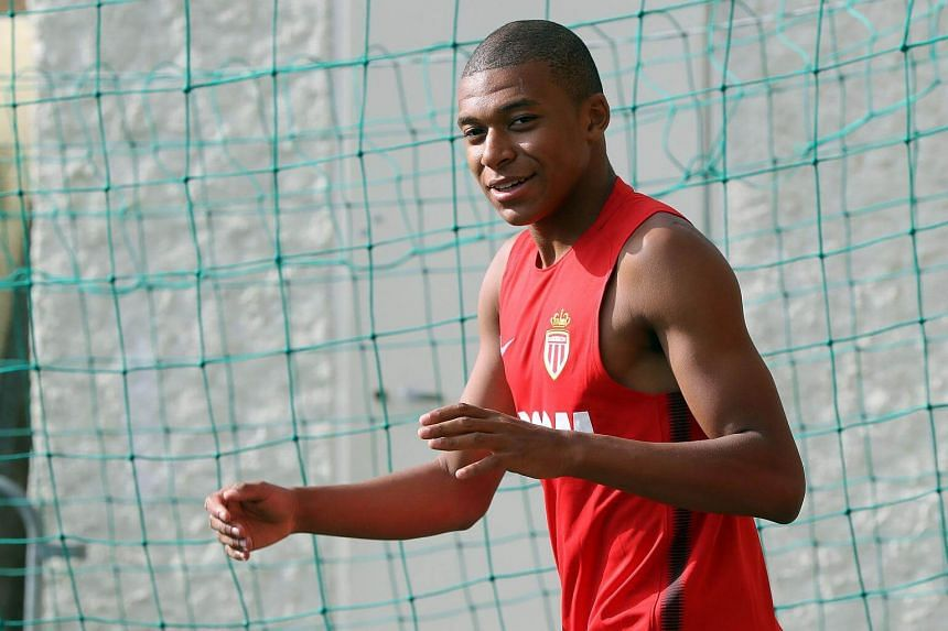Monaco's French forward Kylian Mbappe arrives for a training session in La Turbie, on July 10, 2017.