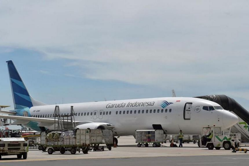A passenger was removed from a Garuda Indonesia flight after joking about carrying a bomb in his bag.