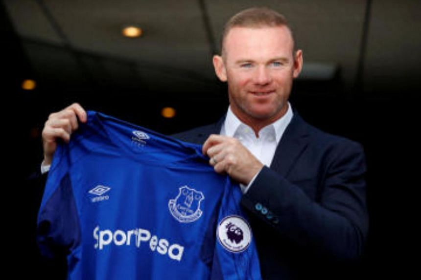 Everton's Wayne Rooney poses with the club shirt after the press conference.
