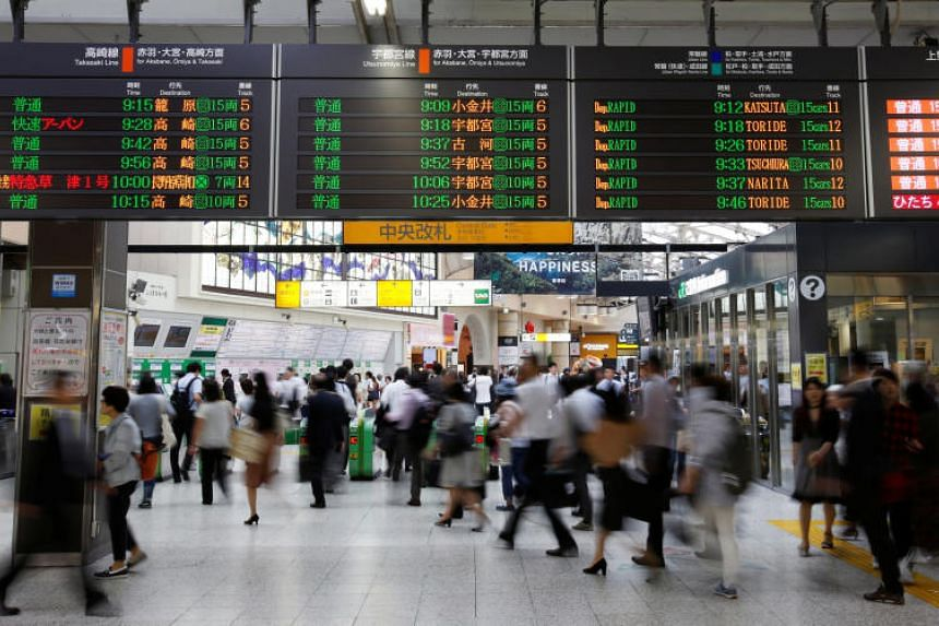 Commuters at Ueno Station in Tokyo on June 16, 2017.