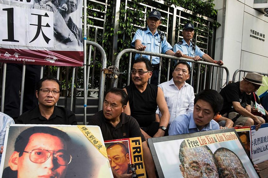 Pro-democracy protesters attending a sit-in protest outside the Chinese Liaison Office in Hong Kong on July 10, 2017, to demand the release of China's cancer-stricken Nobel laureate Liu Xiaobo.