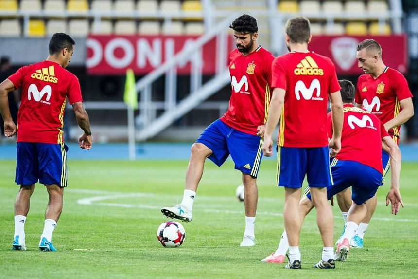 Spain's Diego Costa (centre) takes part in a training session in Skopje, on June 10, 2017.