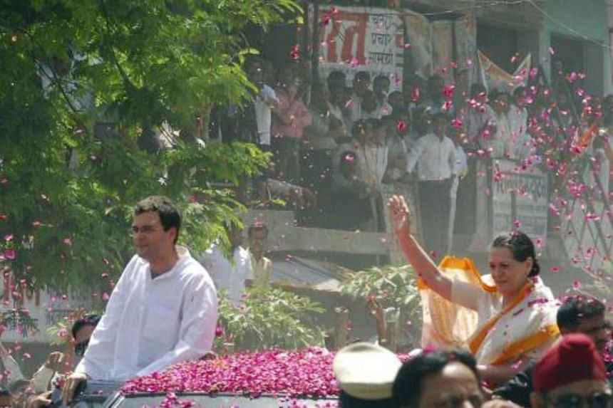 Chief of India's ruling Congress party Sonia Gandhi (right) gestures on her way to file the nomination of her son Rahul Gandhi (left) on April 4, 2009.