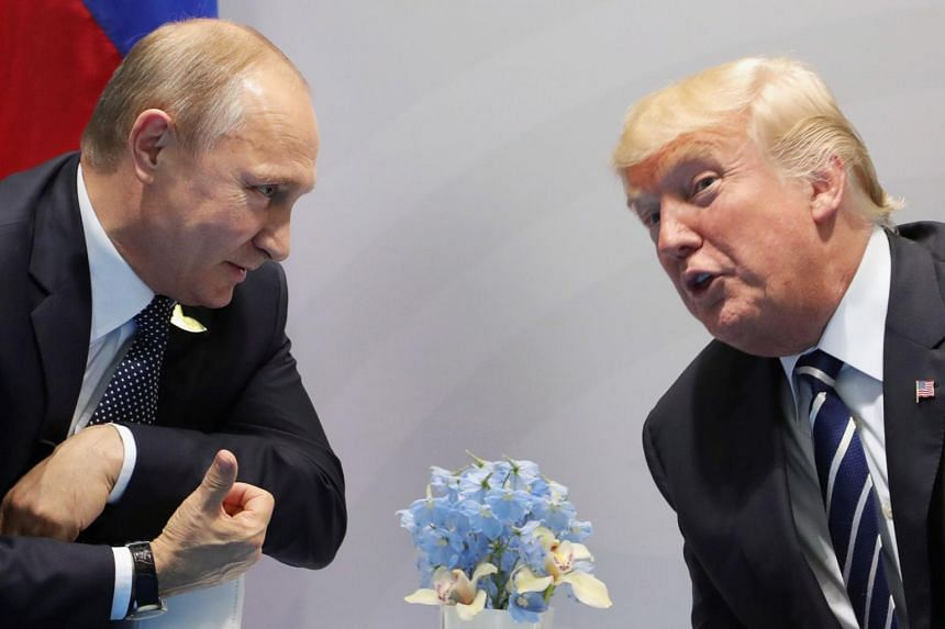 US President Donald Trump (right) and Russia's President Vladimir Putin speak during their meeting on the sidelines of the G-20 Summit in Hamburg, Germany, on July 7, 2017.
