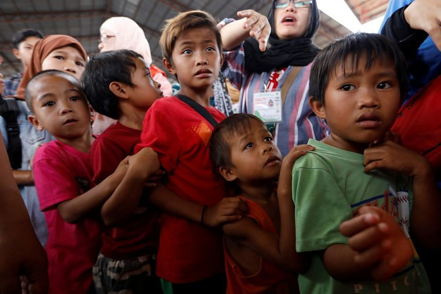 Children line up to receive lunch at an evacuation center outside the city as army troops continue their assault against insurgents from the Maute group in Marawi city, Philippines, on July 5, 2017.