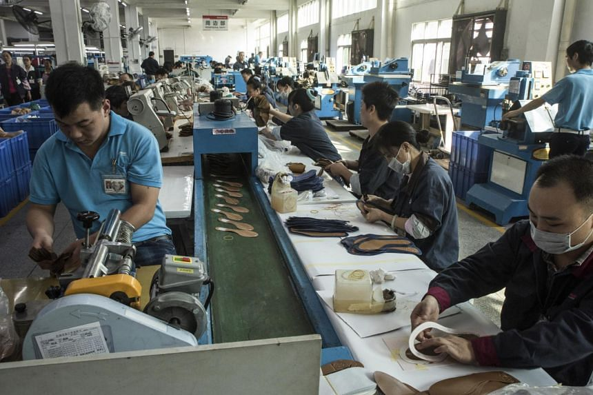 Workers on an assembly line at a Huajian International shoe factory, which makes shoes for Ivanka Trump and other designers, in Dongguan, China.