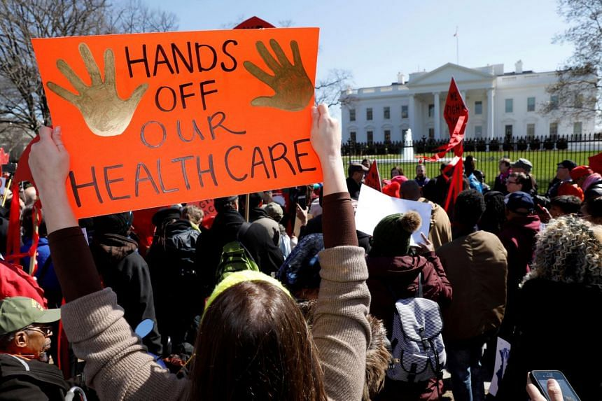 Protesters demonstrate against US President Donald Trump and his plans to end Obamacare outside the White House in Washington, US.