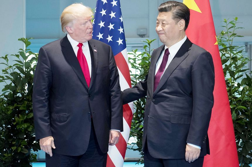 US President Donald Trump and Chinese President Xi Jinping meeting on the sidelines of the G-20 Summit in Hamburg, Germany, on Saturday. Mr Trump's disappointment over his failure to persuade Mr Xi to force Pyongyang to denuclearise the Korean penins