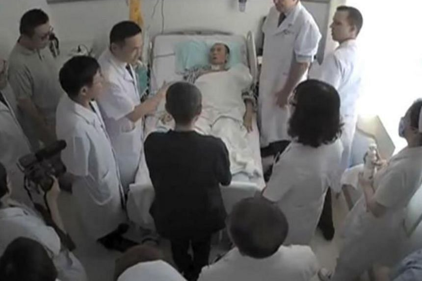 An undated video grab showing Chinese Nobel Laureate Liu Xiaobo (centre) surrounded by doctors and his wife Liu Xia at an undisclosed location.