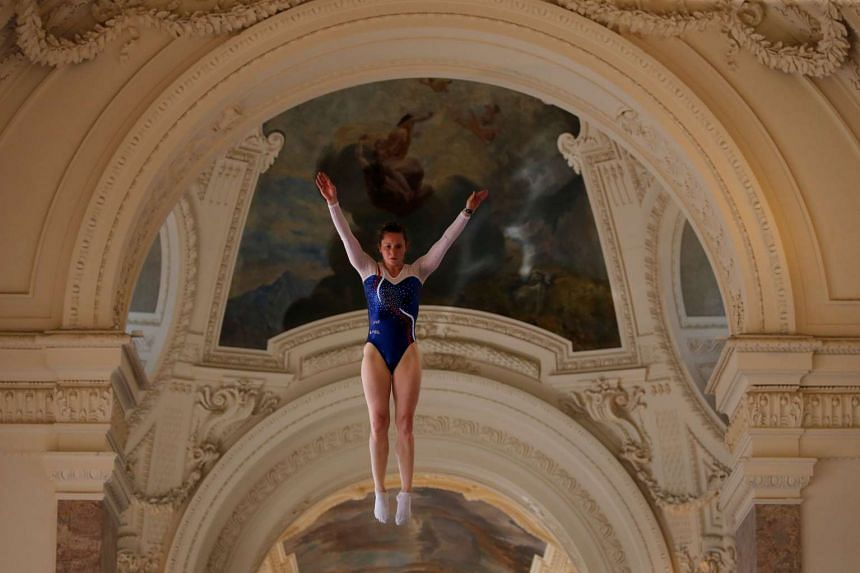 A gymnast performs on a trampoline at the Petit Palais in Paris, France, June 23, 2017 as Paris transforms into a giant Olympic park to celebrate International Olympic Days.
