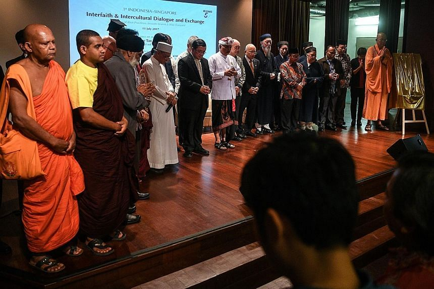 Leaders and representatives of different faiths from Indonesia and Singapore observing a minute of silence yesterday before the launch of the 1st Indonesia- Singapore Interfaith and Intercultural Dialogue and Exchange held in conjunction with the 50t