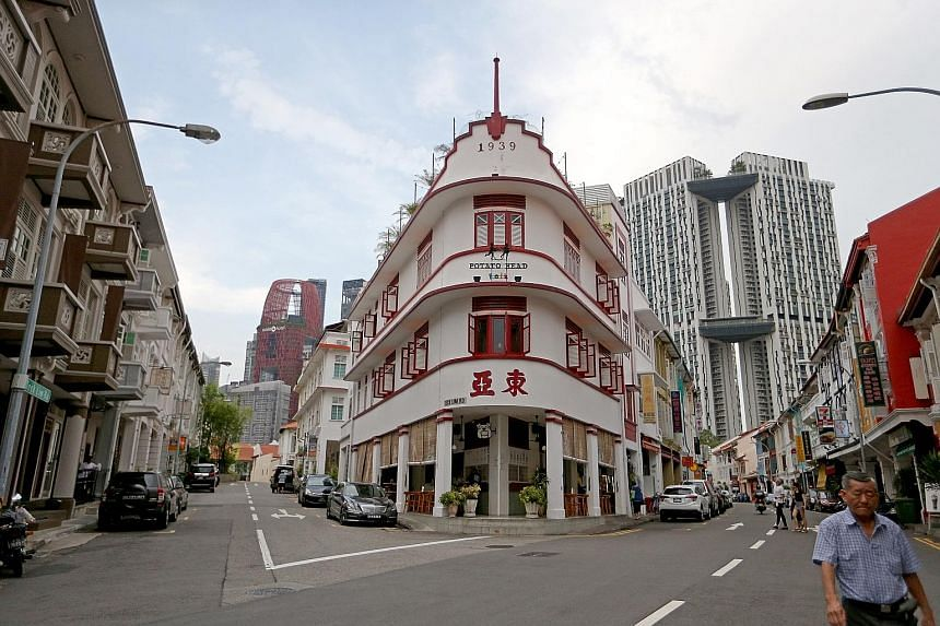 """Keong Saik Road in Chinatown is among the top 10 travel destinations in Asia, according to travel guide Lonely Planet's 2017 Best in Asia list, which was revealed yesterday. The former red-light district was a hotbed for crime, but has """"reinvented it"""