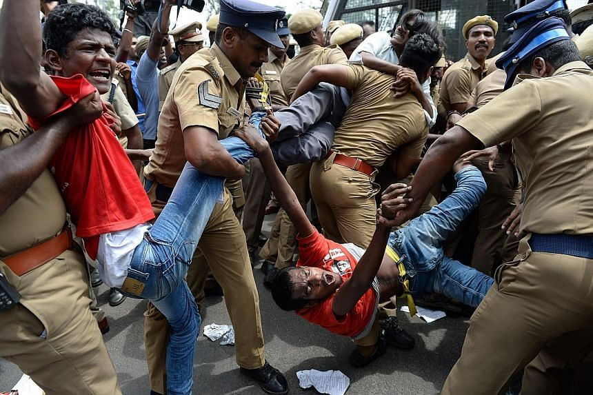 Indian police removing members of the Revolutionary Students and Youth Front during a protest against Prime Minister Narendra Modi and the ban on the sale of cows for slaughter in Chennai on May 31.