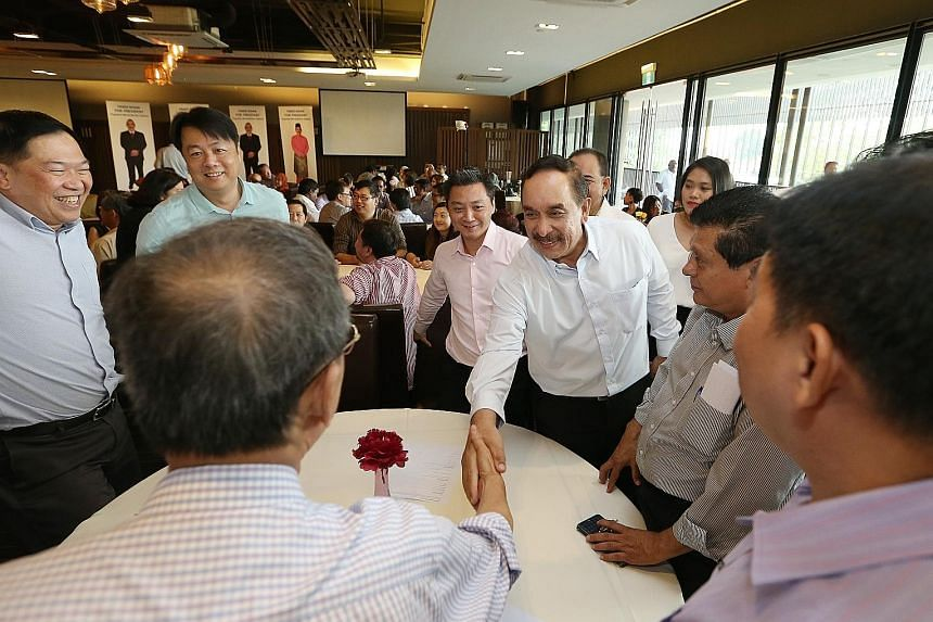 Mr Farid Khan Kaim Khan greeting supporters at the Civil Service Club in Changi yesterday.