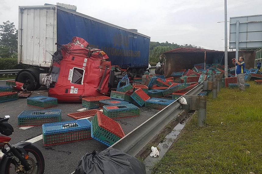 An accident between two trailer trucks on the Second Link Expressway in Johor injured three people and blocked two of three Malaysia-bound lanes yesterday afternoon. The trucks collided just before the Malaysian Customs and immigration complex, causi