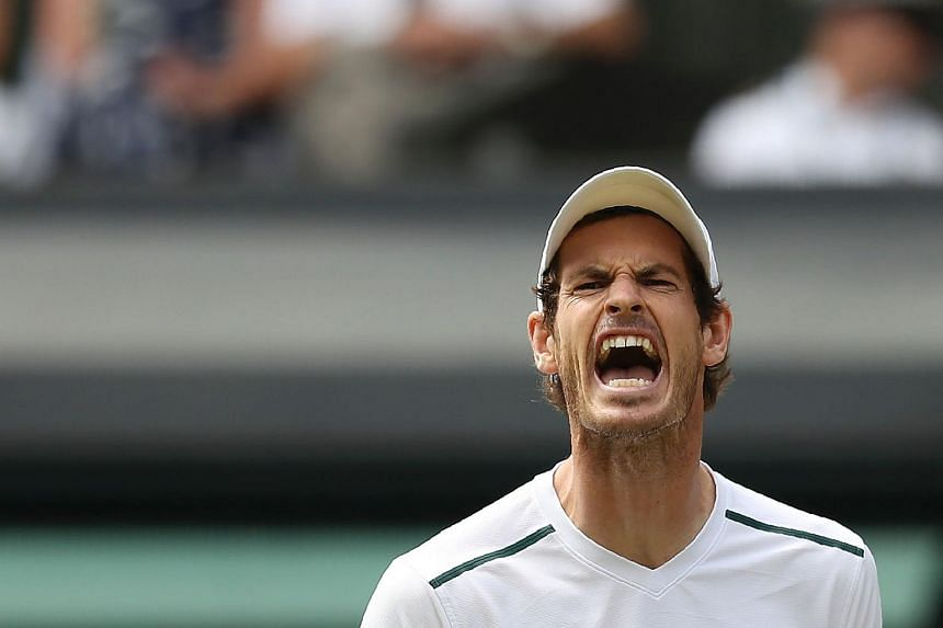 Andy Murray reacts after a point against Sam Querrey during their men's singles quarter-final match on the ninth day of the 2017 Wimbledon Championships, on July 12, 2017.