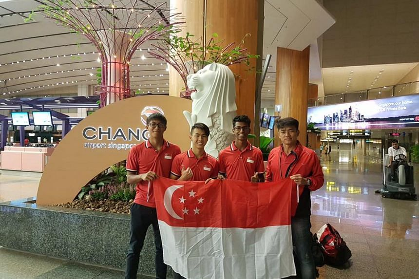 (From left) Athletes Chong Wei Guan, Joshua Chua and Thiruben Thana Rajan along with coach Melvin Tan preparing to head to the IAAF World Youth Championships in Nairobi, Kenya, on July 10, 2017.