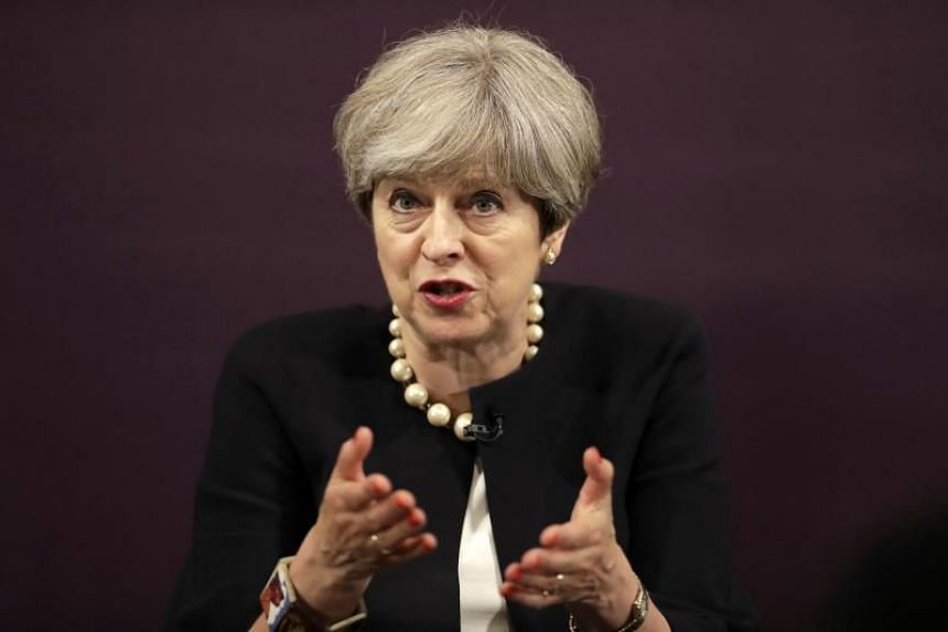 Britain's Prime Minister Theresa May came under fresh pressure on Tuesday (July 11) to soften her Brexit position, adding to uncertainty about her negotiating strategy with Brussels one year after she became Britain's leader.