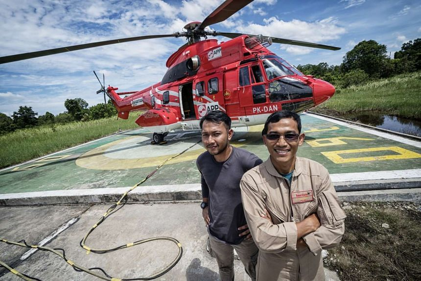 Mr Teo (left), flight operations and Super Puma pilot second-in-command Mr Arif Budiarto (right) fight fires from the air.