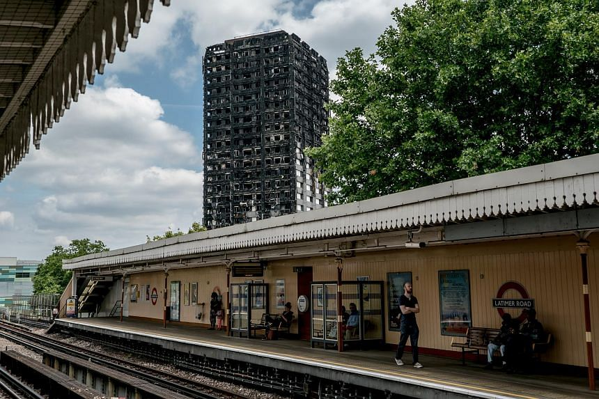 What remains of Grenfell Tower, seen from a local Underground platform, in London on July 1, 2017.