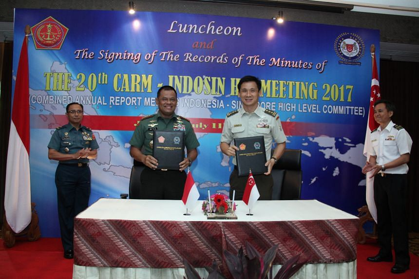 Indonesia's Chief of Defence Force Gatot Nurmantyo and his Singapore counterpart Perry Lim at Tuesday's 20th Combined Annual Report Meeting Indonesia-Singapore High Level Committee in Jakarta.