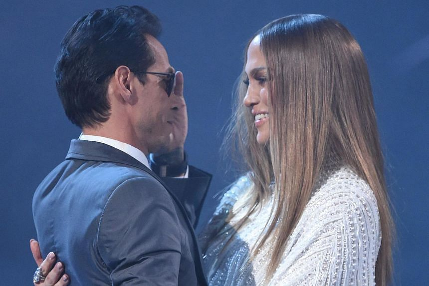 This file photo taken on Nov 17, 2016, shows Jennifer Lopez as she hugs Marc Anthony during the 17th Annual Latin Grammy Awards in Las Vegas, Nevada.
