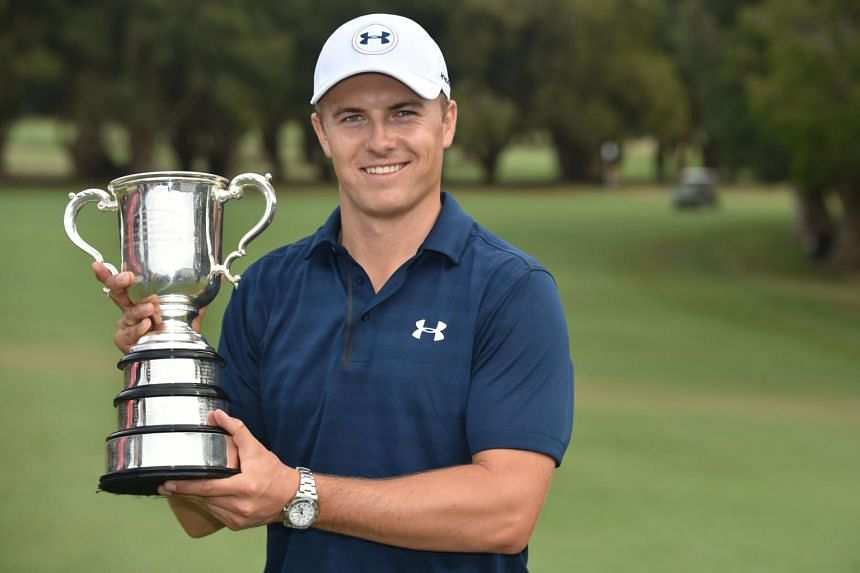 This file photo taken on Nov 20, 2016 shows US golfer Jordan Spieth posing with the Stonehaven Cup after winning the Australian Open golf tournament at the Royal Sydney Golf Club in Sydney.