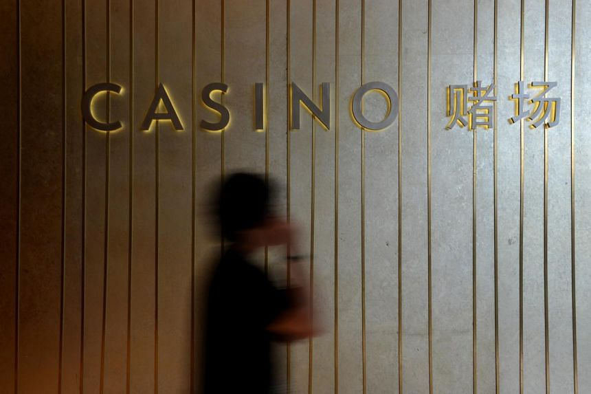 A man walking out of the Marina Bay Sands casino.