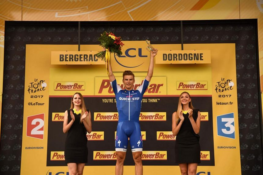 Stage winner Germany's Marcel Kittel celebrates on the podium after winning the 178 km tenth stage of the 104th edition of the Tour de France cycling race between Perigueux and Bergerac, France, on July 11, 2017.