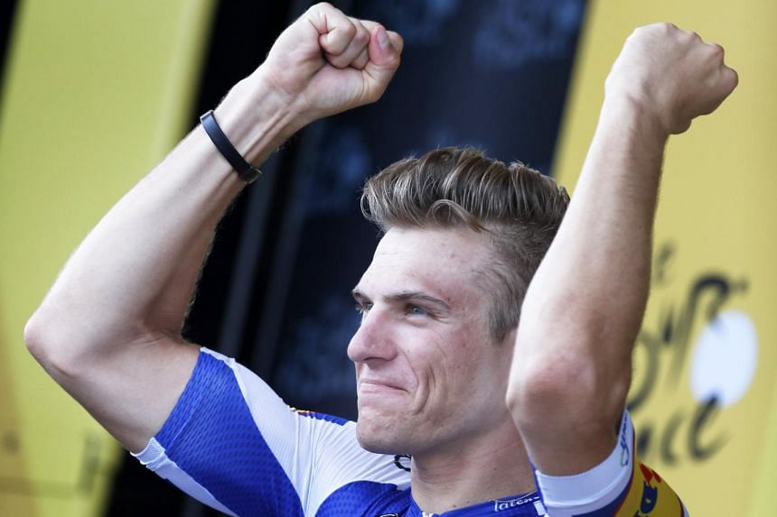 Marcel Kittel of Germany celebrates on the podium after winning the 10th stage of the 104th edition of the Tour de France cycling race over 178km between Perigueux and Bergerac, on July 11, 2017.