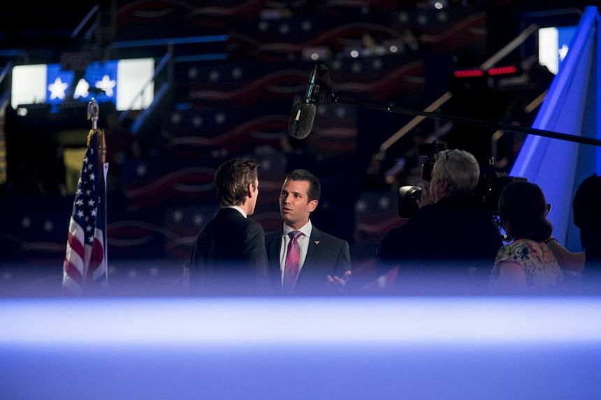 Donald Trump Jr speaks to reporters at the Republican National Convention, in Cleveland.
