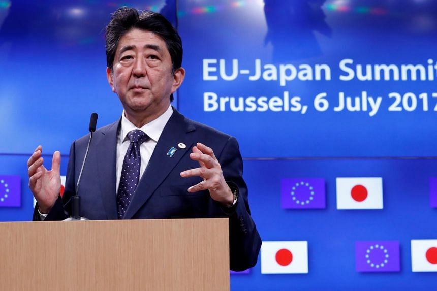 Japan's Prime Minister Shinzo Abe at an EU-Japan summit in Brussels. With approval ratings for his party falling, Mr Abe plans a personnel reshuffle on Aug 3.