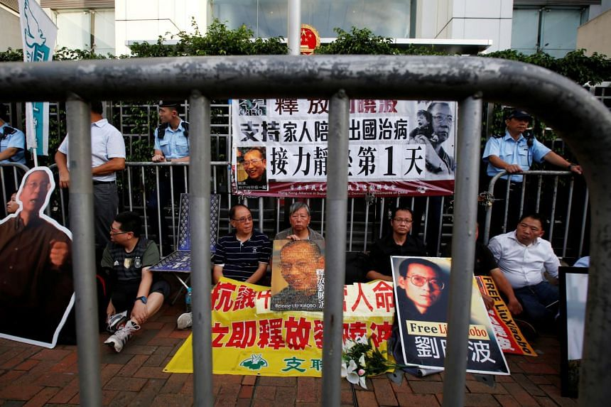 Pro-democracy activists stage a sit-in protest demanding the release of Nobel laureate Liu Xiaobo.