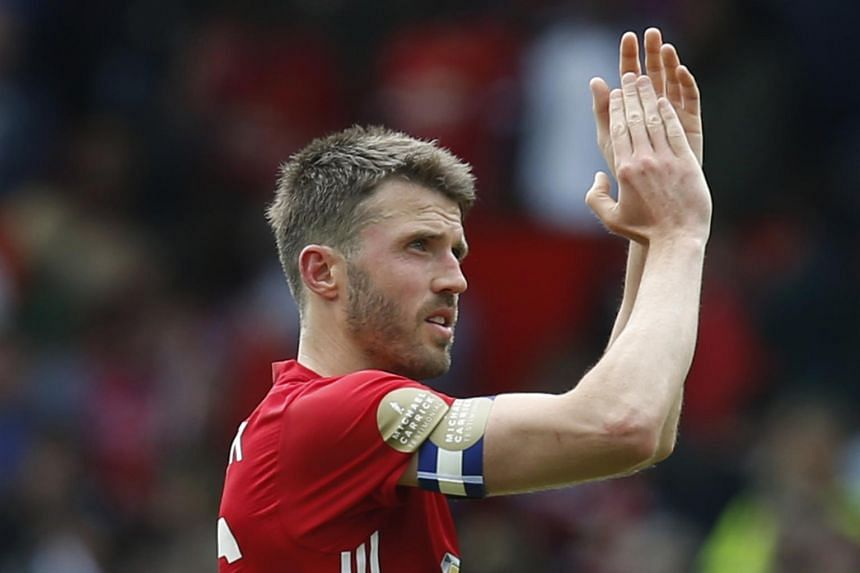 Michael Carrick applauds fans after his testimonial match at Old Trafford.