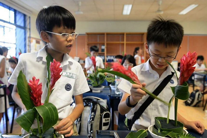 Pupils at Nanyang Primary School learning about art and science through flower arrangement.