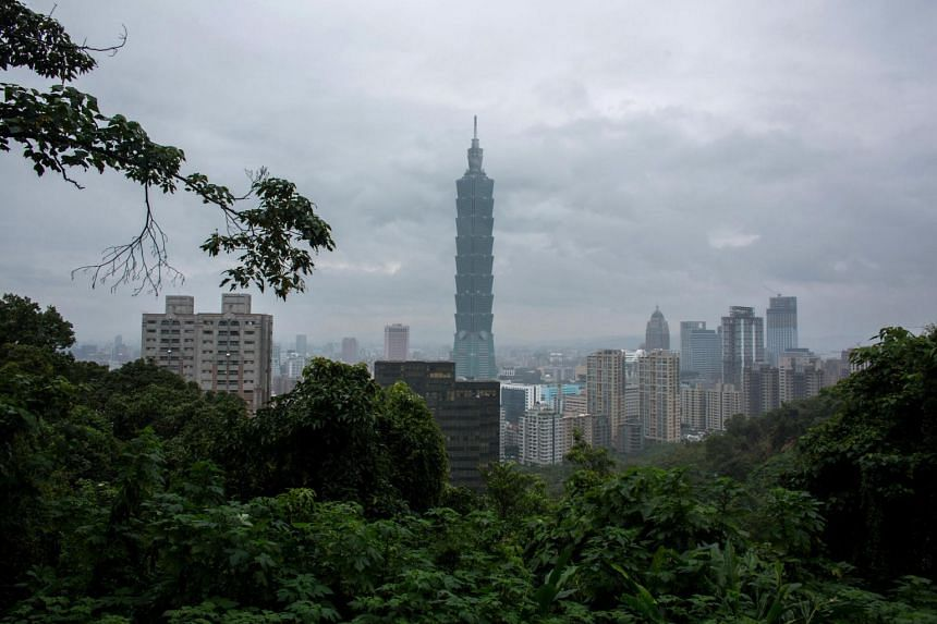 The Taipei 101 building, center, stands among residential and commercial buildings in Taipei, Taiwan.