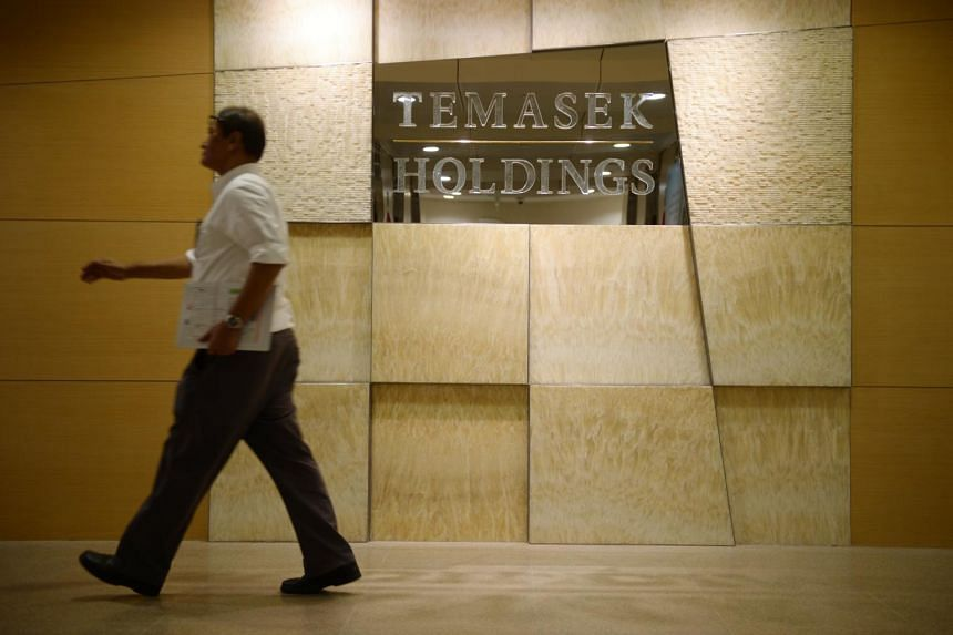 A man walking past the Temasek Holdings office.