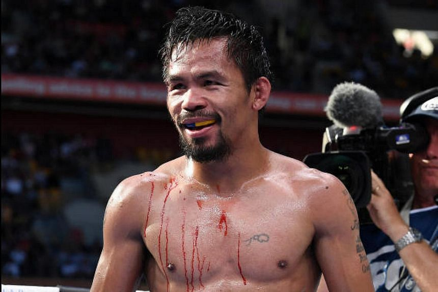 Bloodied Manny Pacquiao of the Philippines is seen during the fight with Jeff Horn on July 2.