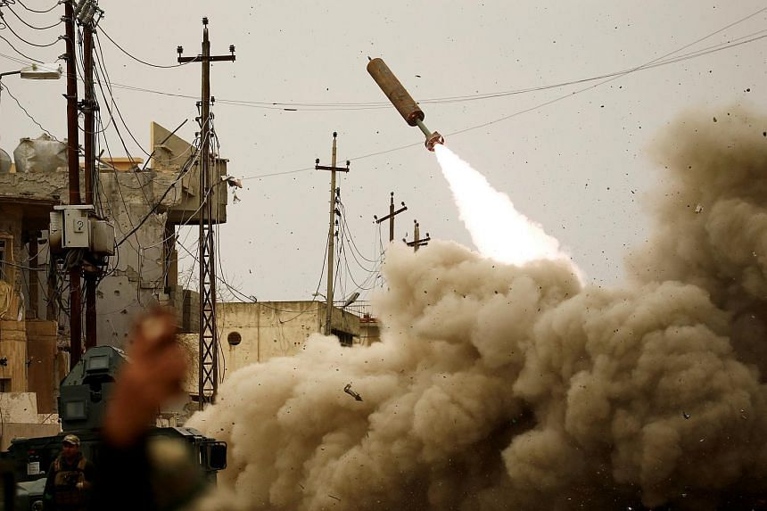 Iraqi rapid response members fire a missile against Islamic State militants during a battle with the militants in Mosul, Iraq on March 11, 2017.