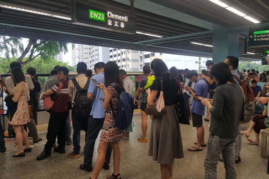 A long line of commuters seen at Clementi station on the East-West Line.
