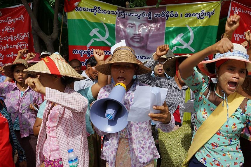 Farmers shout during a protest in Mandalay, in Central Myanmar on July 12, 2017.