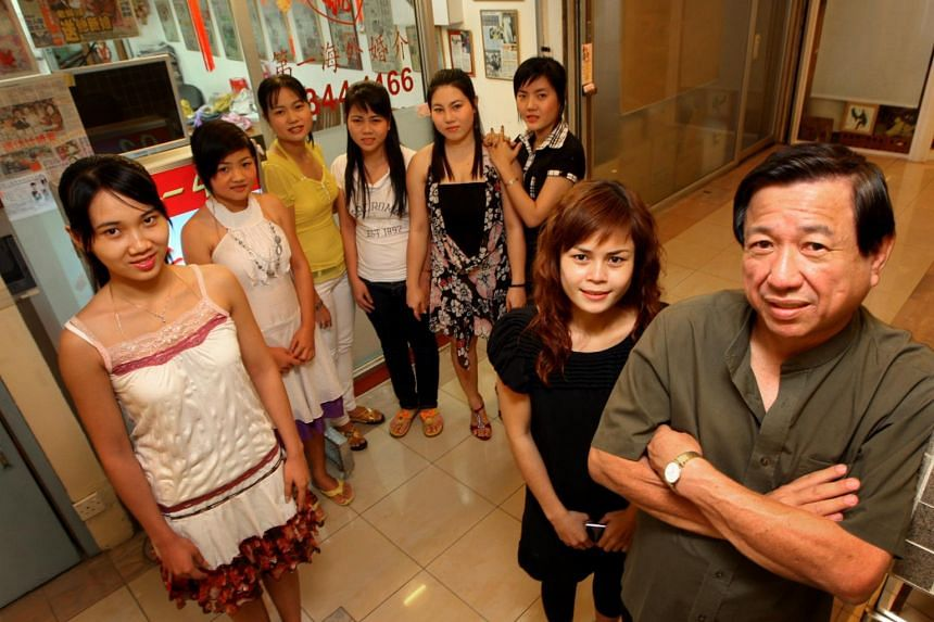 Mr Francis Toh, owner of First Overseas International Matchmaker, and his wife, Madam Rachel Nguyen, with some prospective Vietnamese brides.