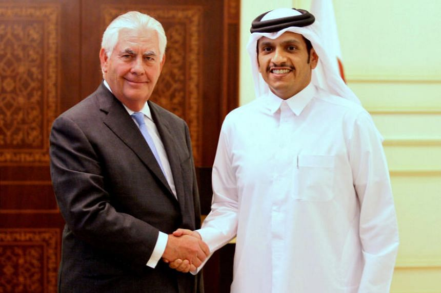 Qatar's foreign minister Sheikh Mohammed bin Abdulrahman al-Thani (R) shakes hands with U.S. Secretary of State Rex Tillerson following a joint news conference in Doha, Qatar, July 11, 2017.