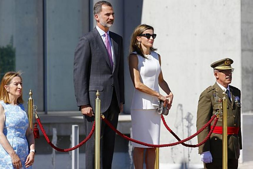 The Spokeswoman of the Lower Chamber of the Spanish Parliament Ana Pastor (left) stands next to Spanish King Felipe VI and Queen Letizia  upon their arrival to the official farewell ceremony at Adolfo Suarez Barajas airport in Madrid, Spain on July 1
