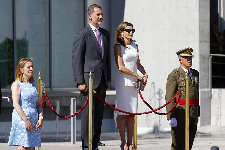 The Spokeswoman of the Lower Chamber of the Spanish Parliament Ana Pastor (left) stands next to Spanish King Felipe VI (second left) and Queen Letizia upon their arrival to the official farewell ceremony at Adolfo Suarez Barajas airport in Madrid.