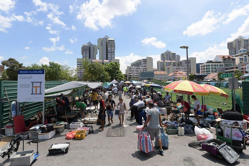 Visitors throng the Sungei Road Thieves Market on its last day, on July 10, 2017.