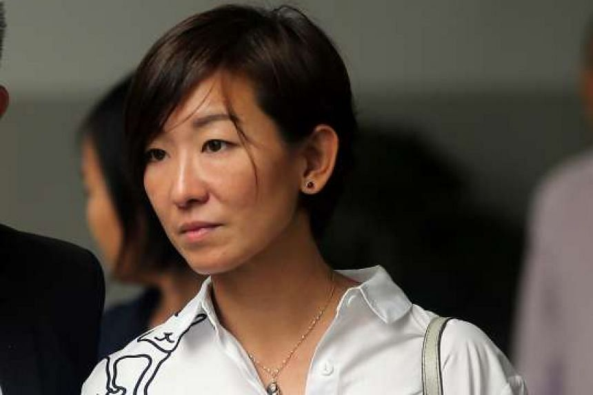 The accused's daughter and wife of the victim, Ms Tan Cheng Cheng.