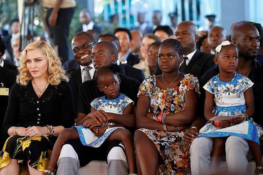 American pop superstar Madonna (left) on Tuesday took her four adopted Malawian children - David Banda and Mercy James, both 11, and twins Esther and Stella Mwale, four - back to their home country for the opening of a children's hospital that her ch