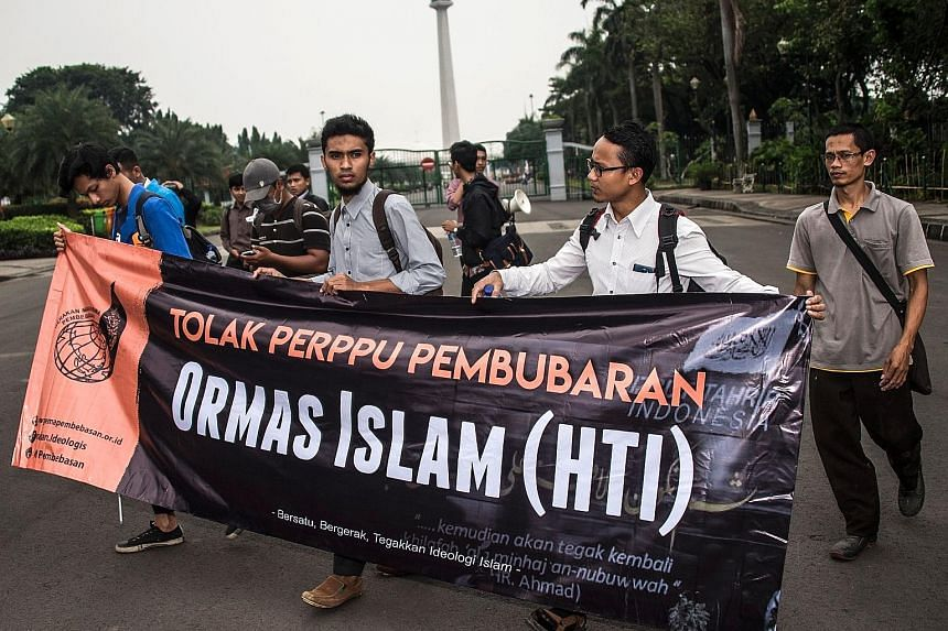 Muslim student activists taking part in an anti-government rally in Jakarta yesterday after Indonesia issued a decree allowing it to ban groups that oppose its official state ideology, Pancasila. Activists said the move is aimed at disbanding Hizb ut