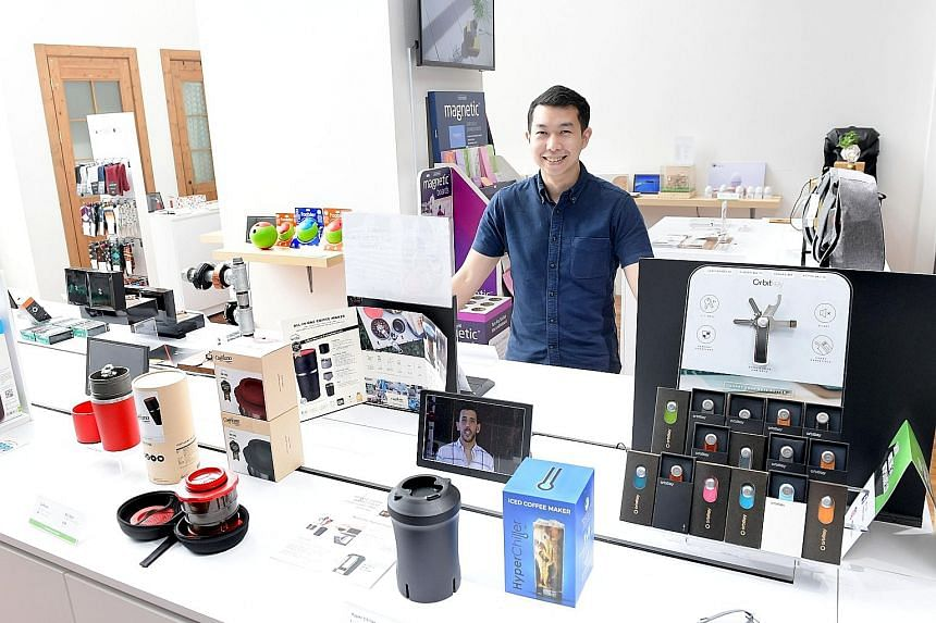 Mr Ryan Sim and Mr Joel Liew raised A$130,000 despite asking for only A$5,000 with their third wallet design Aki (above). Mr Ryan Sim with products funded through Kickstarter at We The People Store.